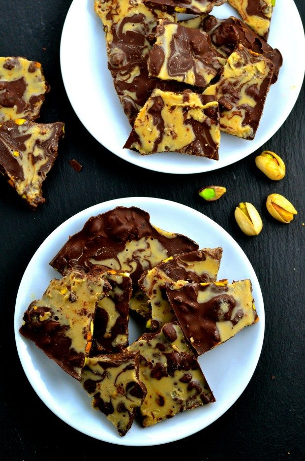 chocolate bark with pistachios on two white plates