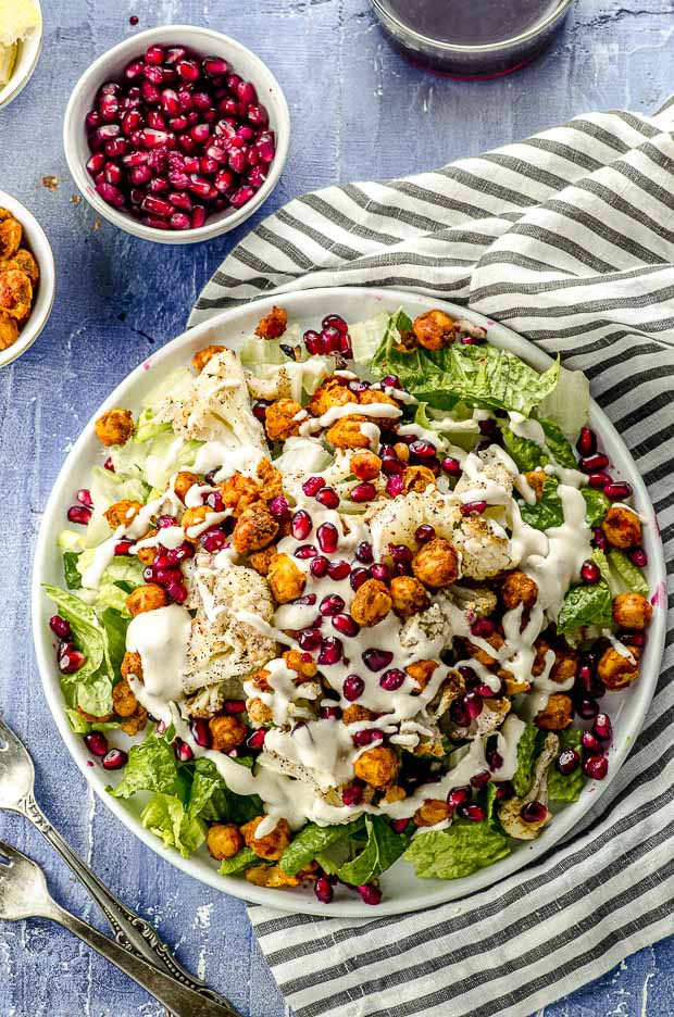 Closeup of a roasted cauliflower salad with spiced chickpeas