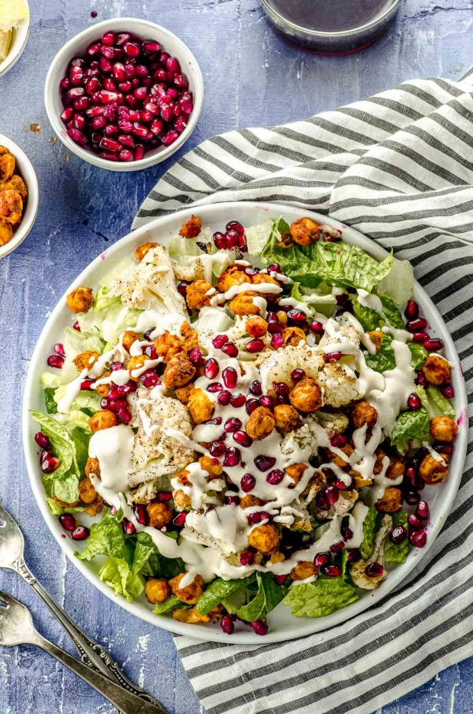 Overhead view of a roasted cauliflower salad with spiced chickpeas