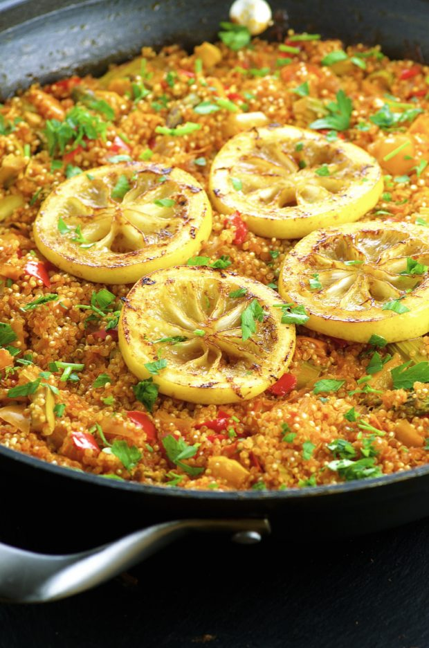 Close up side view of a Vegan Quinoa Paella with lemon slices on top. One of our vegetarian Passover recipes.