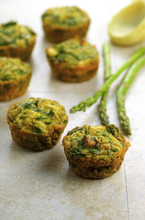 Six minutes Asparagus Artichoke Frittatas on a marble surface. One of our vegetarian Passover recipes.