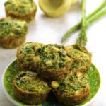 Side view of Individual Artichoke Asparagus Frittatas on a green plate.