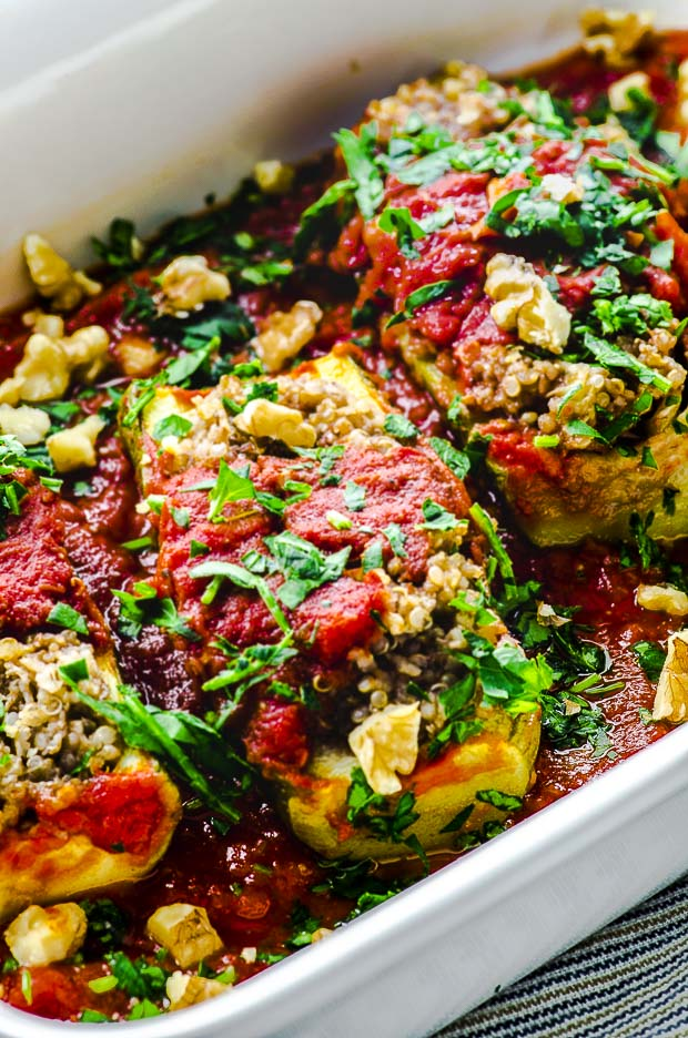 Ac lose up view of a white baking pan with Quinoa Stuffed zucchini boat a great vegan passover recipe