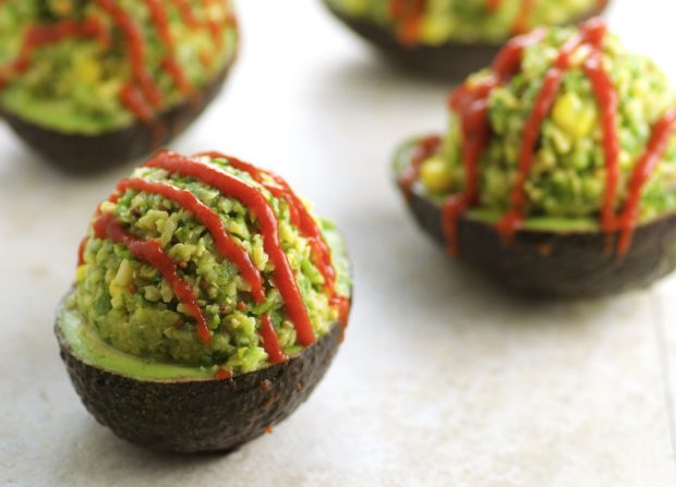 Chickpea Stuffed Avocados, drizzled with Sriracha for a nice kick. A great addition to your Meatless Monday menu this summer and all year long!