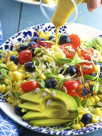 This rice salad is like summer in a plate. Grilled corn, fresh blueberries and juicy tomatoes make this salad a super flavorful side dish for any summer picnic or BBQ. You can have the leftover for lunch too!