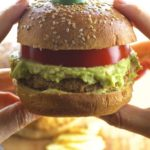 Super tasty and never boring Cauliflower veggie burger with a tangy avocado guacamole. Vegan