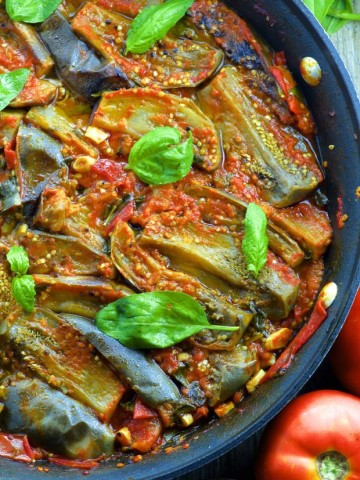A close up view of a pan with Braised eggplant in Fresh Tomato Sauce - Vegan Passover recipes