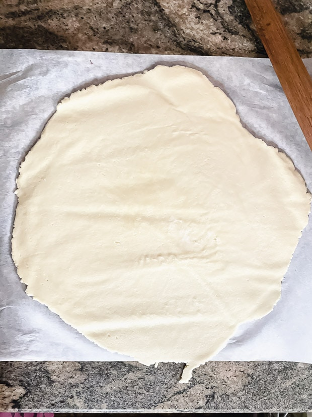 "galette dough rolled into a 14"" inch circle"