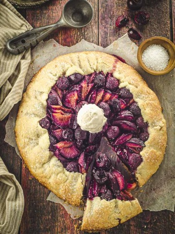 Bird's eye view of a fruit galette with some ice cream on top