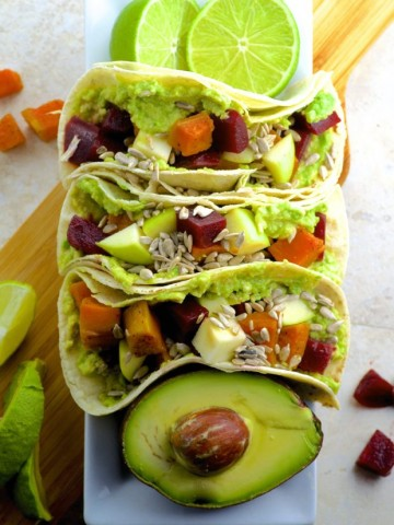 Beet and Sweet Potato Tacos - Nutty Corn tortillas are topped with creamy avocado, roasted beets, sweet potatoes, crunchy apples and if you choose to spice it up drizzle sriracha all over these fall tacos.