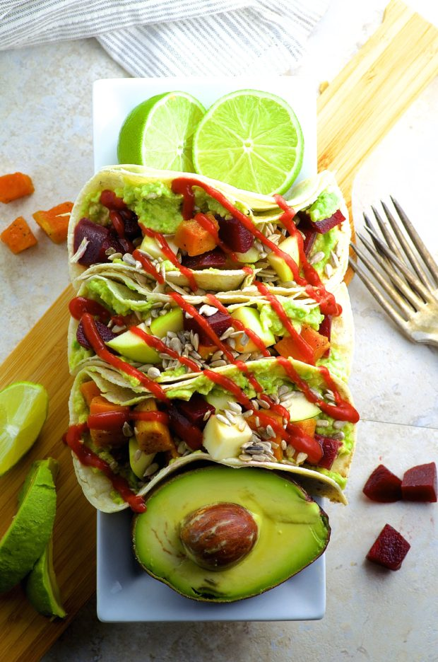 Beet And Sweet Potato Fall Tacos - Nutty Corn tortillas are topped with creamy avocado, roasted beets, sweet potatoes, crunchy apples and if you choose to spice it up drizzle sriracha all over these fall tacos.