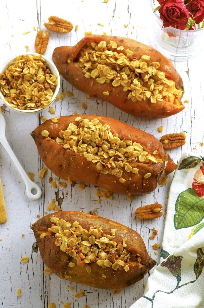 Creamy Thanksgiving stuffed sweet potatoes with a crunchy oat, maple and pecan topping. Vegan, vegetarian, Gluten Free