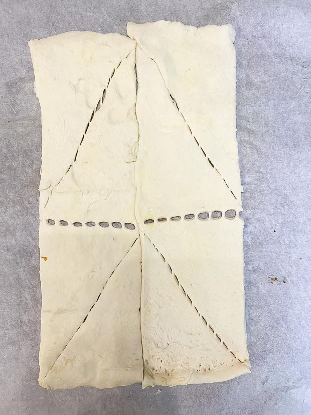 Crescent dough as it comes out of the package with perforations