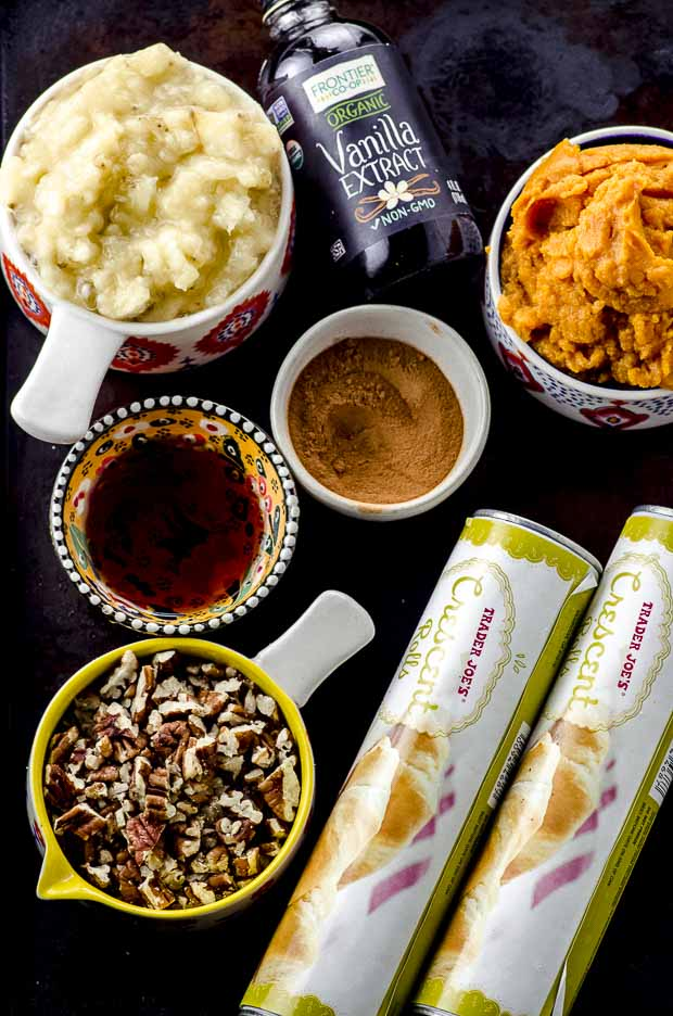 Image of all the ingredients to make banana pumpkin cinnamon rolls. Crescent rolls, pecans, maple syrup, brown sugar, bananas, vanilla extract and canned pumpkin