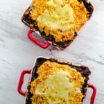 Black bean Chili with Cheesy Corn Bread - This Spiced Black Bean Chili is topped with a homemade crunchy corn bread and cheese crust for a wonderful contrast of flavors and textures. Want a make it Vegan just use Vegan Cheese instead.