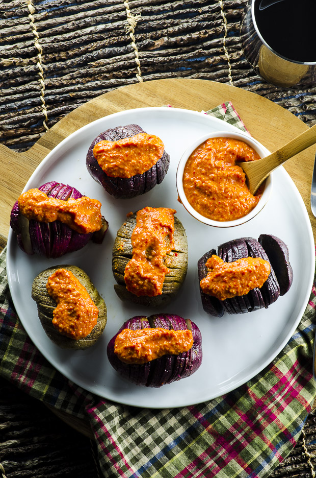 """This colorful and delicious dish is a combination of two of our favorite Spanish recipes: """"Patatas Bravas"""" (roasted potatoes with spicy sauce) and """"Romesco"""", a traditional Spanish sauce / spread that is served along grilled vegetables, meats or with toasted rustic bread. This dish is vegan and can be served as an appetizer or side dish."""