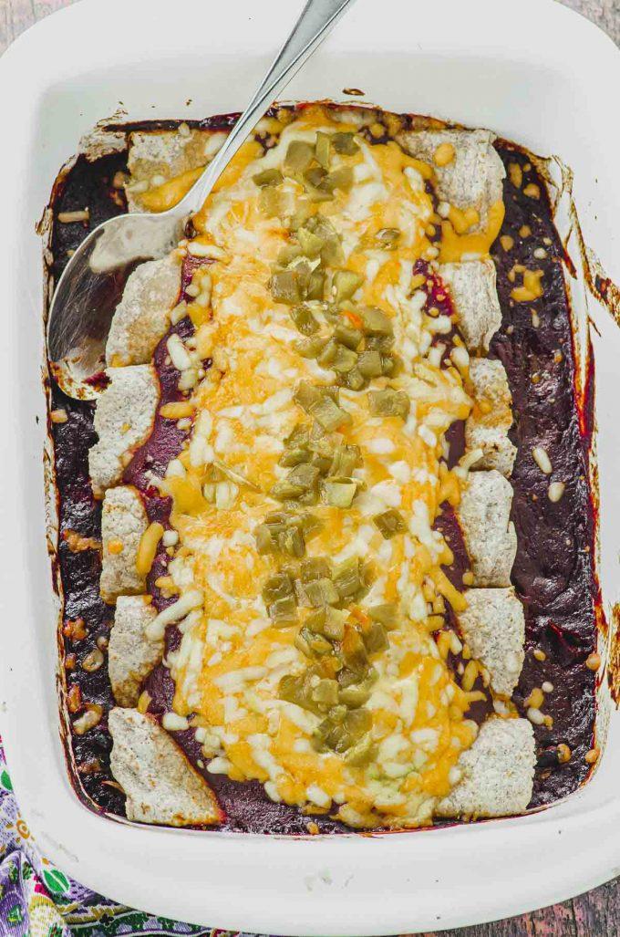 Baked vegetarian enchiladas on a white baking dish