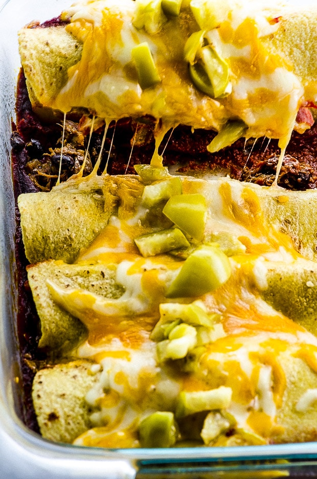 You will not miss the meat in these Pulled Jackfruit Enchiladas! Filled with spiced pulled jackfruit and on a homemade chipotle enchilada sauce. You can make them vegan or vegetarian, and adjust the heat to your liking.