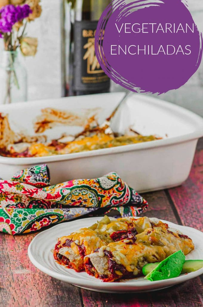 a plate with two vegetarian enchiladas with a baking dish and a bottle of wine on the background