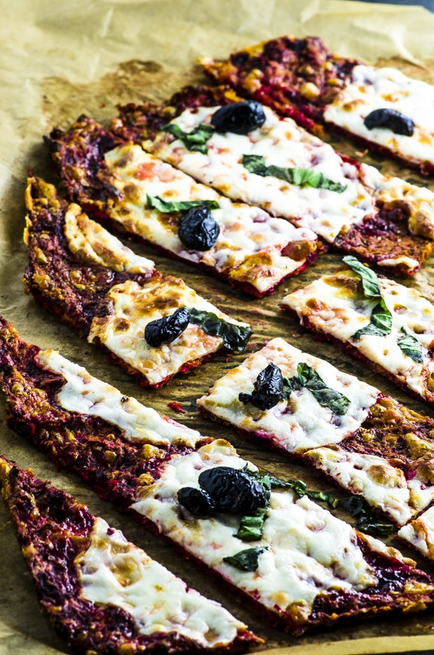 Side view of a Beet and Cauliflower Crust Pizza, sliced