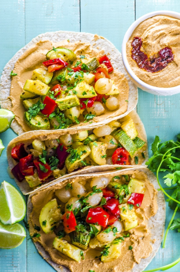 Get a head start on your Taco Tuesday and Cinco de Mayo prep with these vegan Chipotle Hummus And Roasted Vegetable Tacos! With a nice spicy kick from home made chipotle hummus. Use your favorite tortillas and toppings to make them your own.