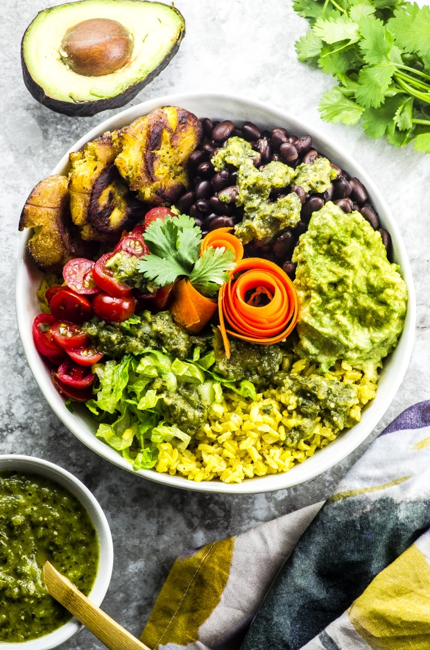 Yellow rice burrito bowl with tostones and tomatillo salsa - great Mexican inspired recipe - vegetarian, vegan , gluten free