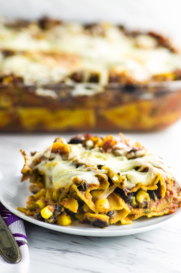 Get ready for a flavor explosion in your mouth! This High Protein Mexican Lasagna will keep you full and satisfied for hours. Gluten free and can be made vegan or vegetarian!
