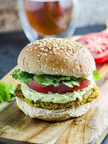 A close up of a Falafel veggie burger with avocado tahini cream , part of our best veggie burgers roundup.