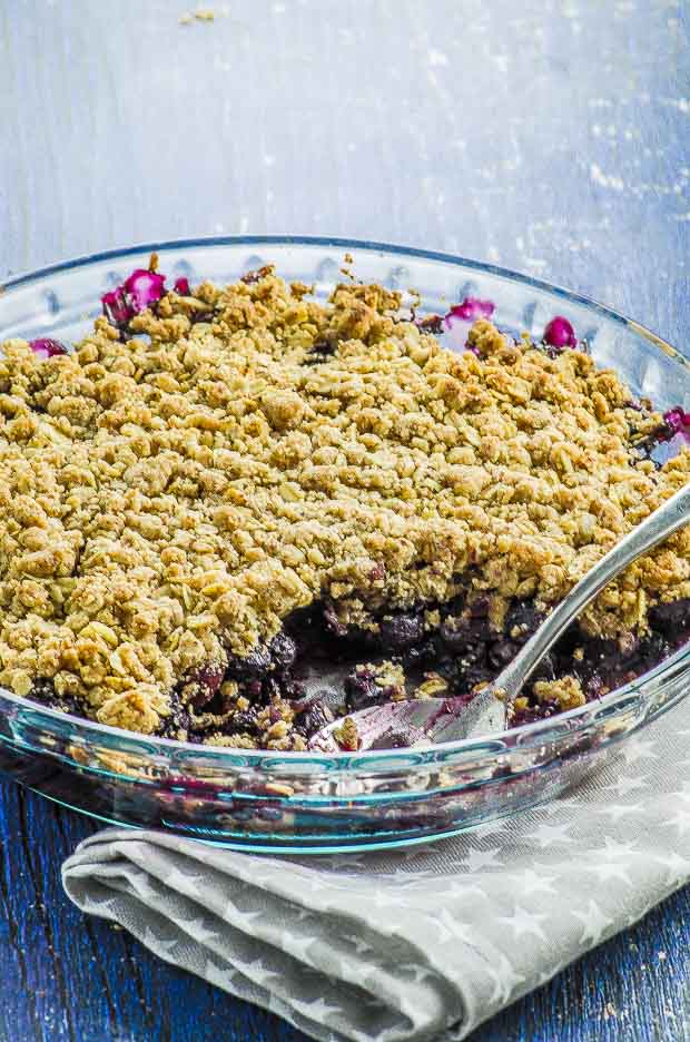This vegan blueberry crumble is like a huge scoop of summer on a plate! Takes less than 10 minutes to prepare, then the oven does the rest of the work! The perfect treat for blueberry lovers.