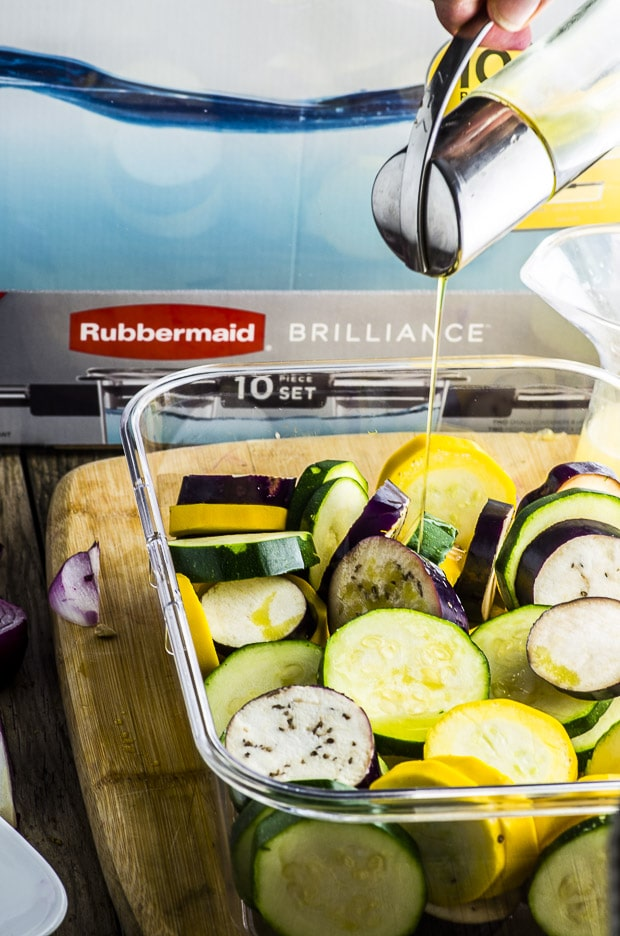 For this Hummus and Grilled Vegetable Pizza recipe, we marinated zucchini, yellow squash and Japanese eggplant in olive, lemon, garlic, coriander, cumin and ginger.  We spread a store bough crust with our home made hummus, instead of cheese for a healthy twist.