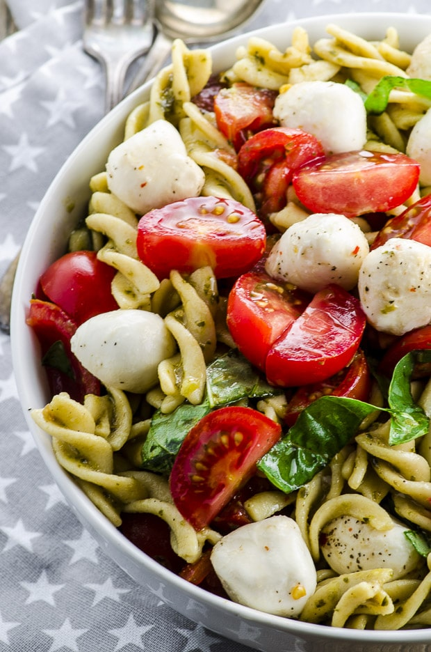 High Protein Caprese Pasta Salad - A light and fresh gluten free dish full of protein and fiber, perfect for lunch or as a light dinner this summer! It can also be made Vegan!