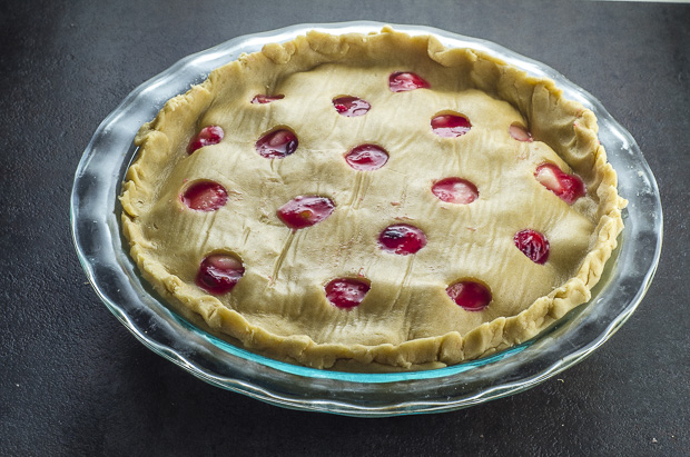 Cranberry Pear Pie with the filling and the cut out top crust right before baking