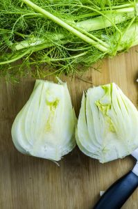 Cutting a fennel bulb in half