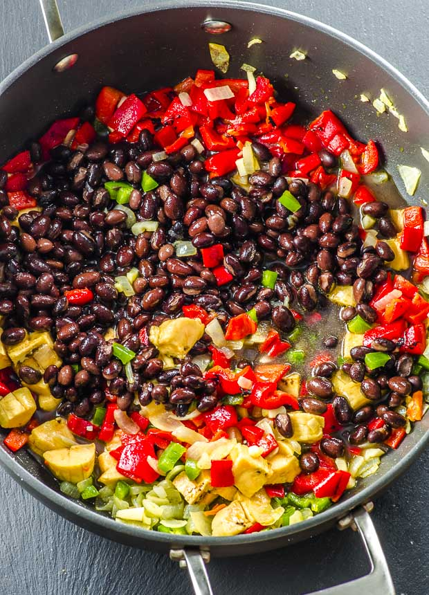 Black beans, plantains, roasted red peppers, jalapeno peppers and onions in a large deep skillet