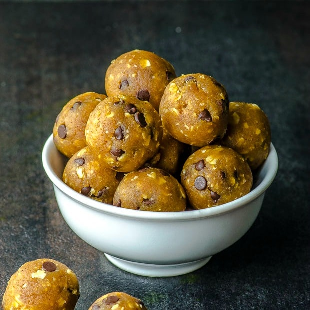 Close up of the chcolate chip chickpea cookie dough balls in a white bowl