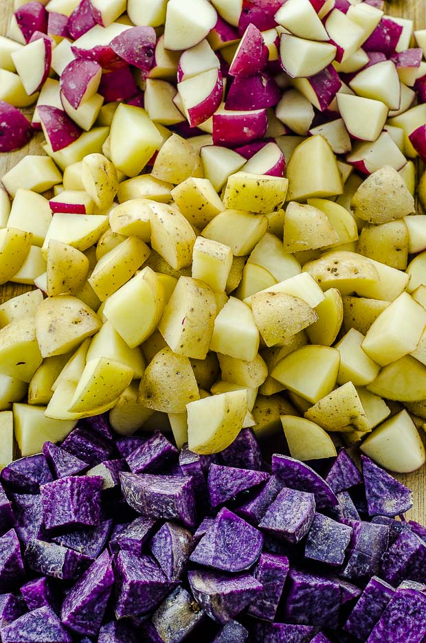 Close up of cup up purple, yellow and red potatoes