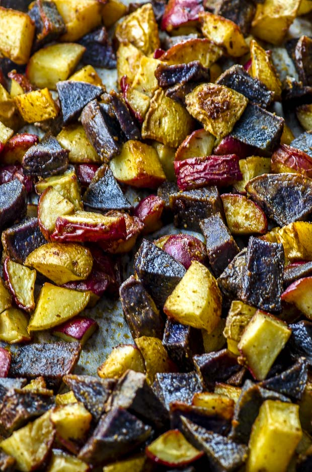 Close up of roasted yellow, red and purple potatoes