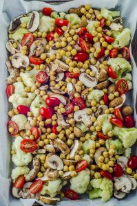 Cauliflower Chickpea Sheet Pan Dinner ingredients in a lined baking sheet