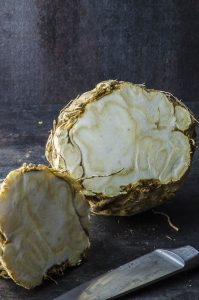 A celeriac ( celery root) cut in half