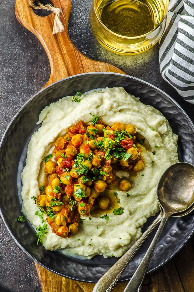 bird'e eye view of chana masala over celeriac puree