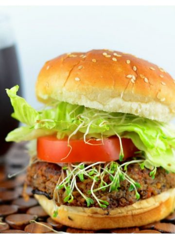 Side view of a black bean veggie burger in a hamburger bun. 4th of July recipes !