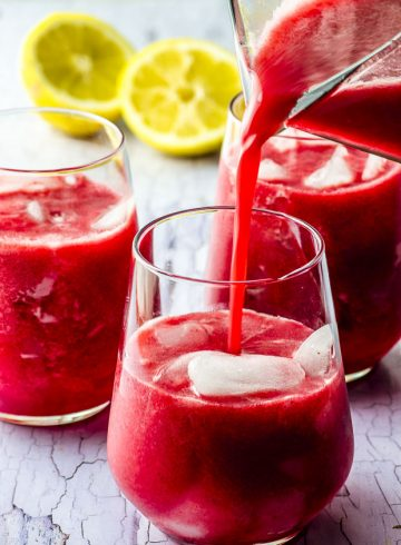 Date Sweetened Raspberry Lemonade. Pouring into one of the glasses with a pitcher