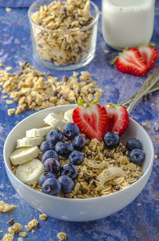 A bowl of nut-free coconut granola with strawberries and blueberries