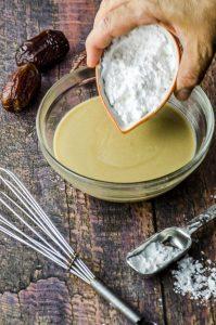 preparing Halva Stuffed Dates Dipped in Chocolate - tahini and sugar