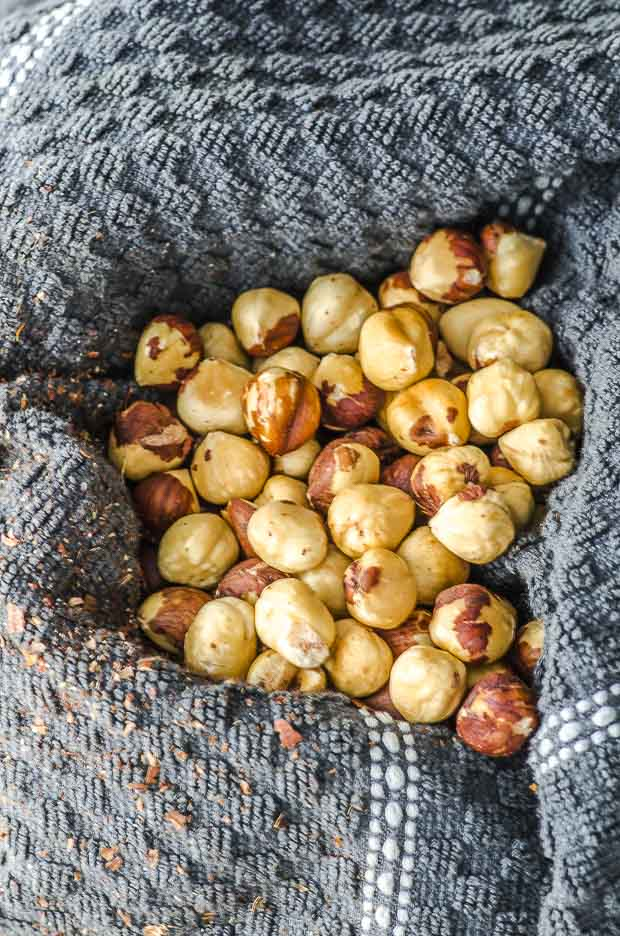Roasted hazelnuts on a kitchen towel with the skins off