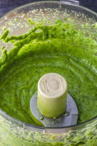Close up of the avocado cilantro dressing in the food processor