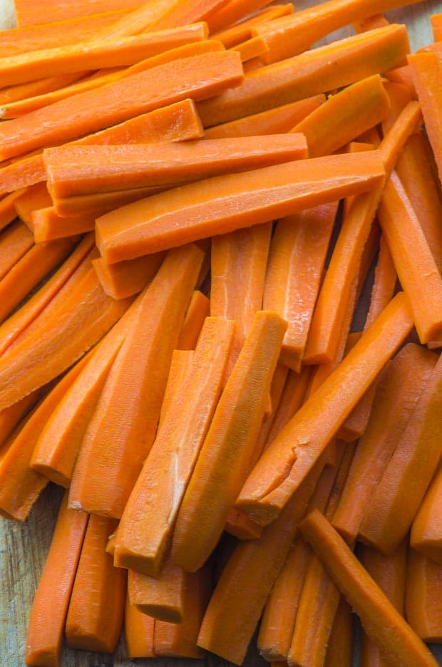 A pile of carrots cut in sticks