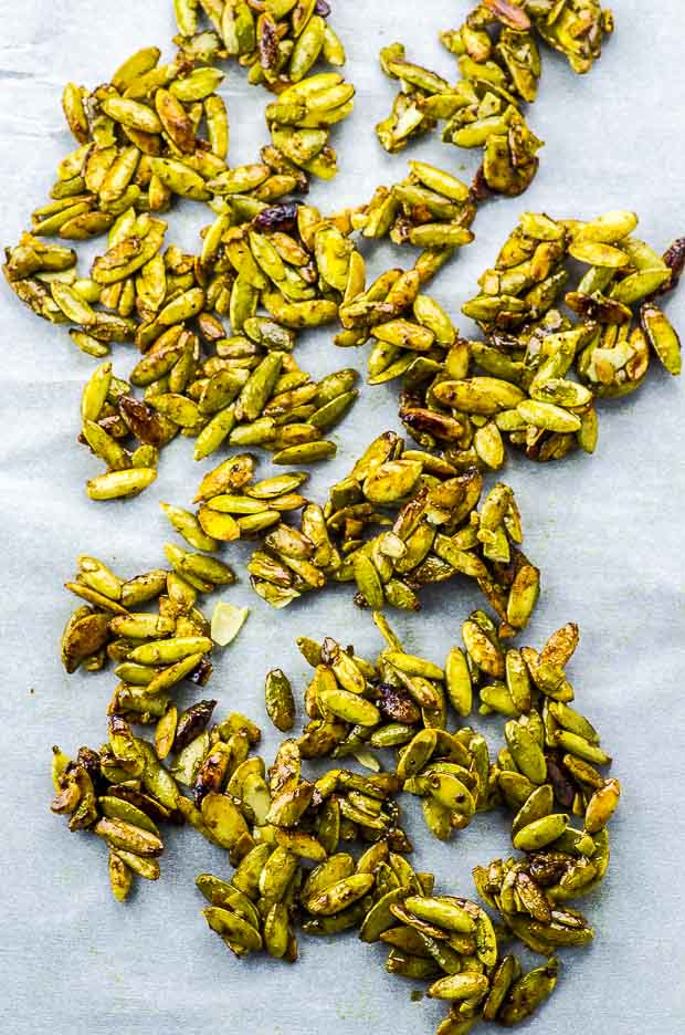 cinnamon ginger spiced pumpkin seeds on parchment paper