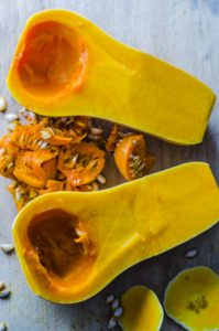 A butternut squash cut in half and seeds removed