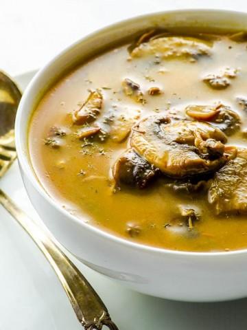 Side view of a white bowl with vegan mushroom gravy